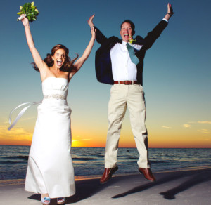 st. pete bride and groom wedding jumping couple