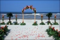 floral arch tropical deluxe two trees four tikis deluxe floral sand aisle.jpg